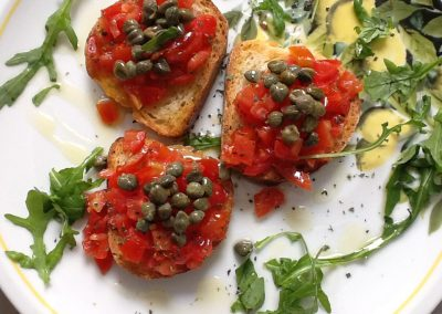 Bruschetta tomatoes and capers