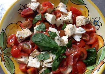 Tomatoes and Buffalo mozzarella with basil leaves