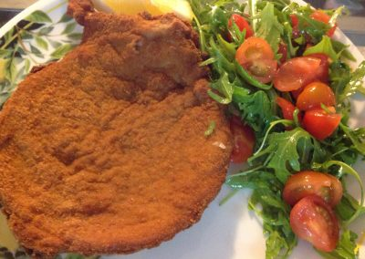 "Cutlet ""Paolino style"" with rucola ant cherry tomatoes"
